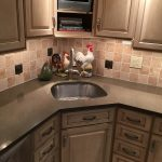 Cambria kitchen with tile backsplash